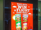Posterscope and Pringles Urge Customers to 'Take a Bite and Win a Flight'