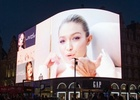 Gigi Hadid Debuts Maybelline Cosmetics Collection On Piccadilly Lights