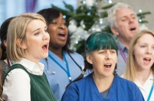 Oliver Warren Directs the NHS Choir's Christmas Chart Topper