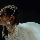 Mandopop Star Bibi Zhou Is Puppet Master in This Ethereal Promo