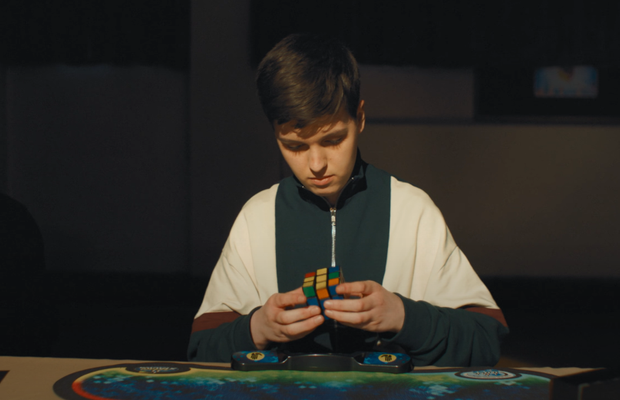 Rubik's Cube Enthusiast Embarks on a Time-Warping Journey in Ross from Friends' New Promo