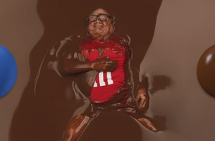 Danny DeVito Bathes in Pool of Chocolate for M&M's Super Bowl Teaser
