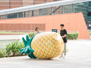 Mysterious Giant Pineapple Rolls Through Singapore for Caltex Fuel