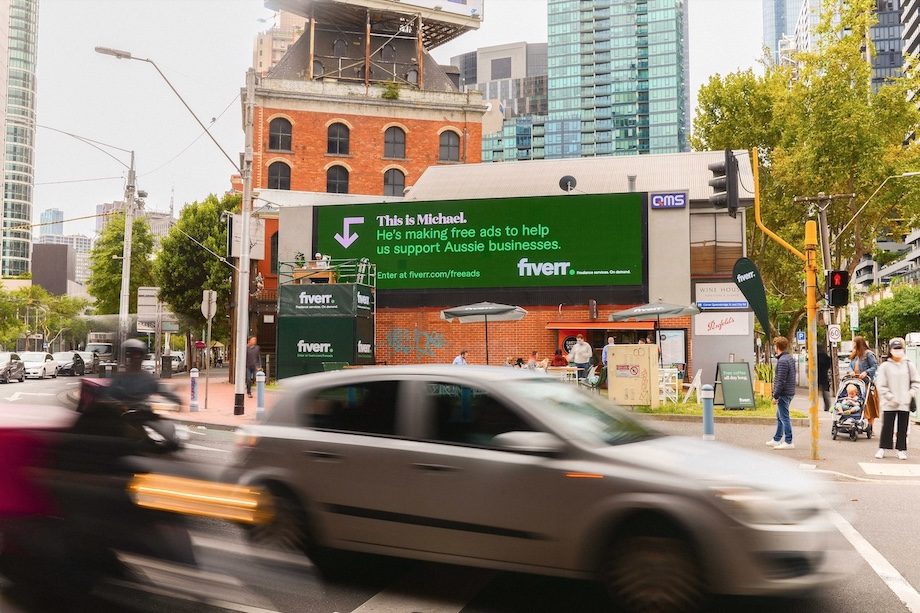 A Freelancer Attached to a Large Format Billboard Makes Ads for Aussie Businesses