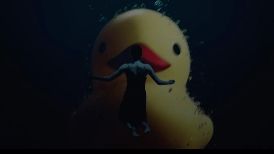 Giant Rubber Duck Ruins Dreamy Seascape Bath in Electronics Brand TCL Spot