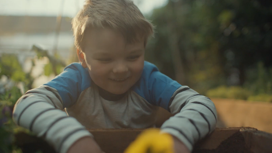 Adorable Little Homemaker Finds a New Best Friend in Summer Campaign for Woodie's