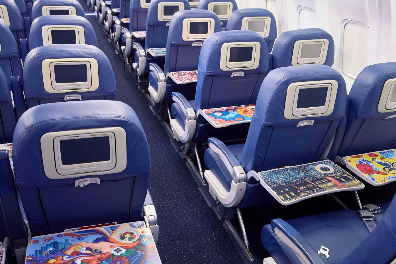 Delta and Coca-Cola Curate a Flying Tray Table Art Gallery