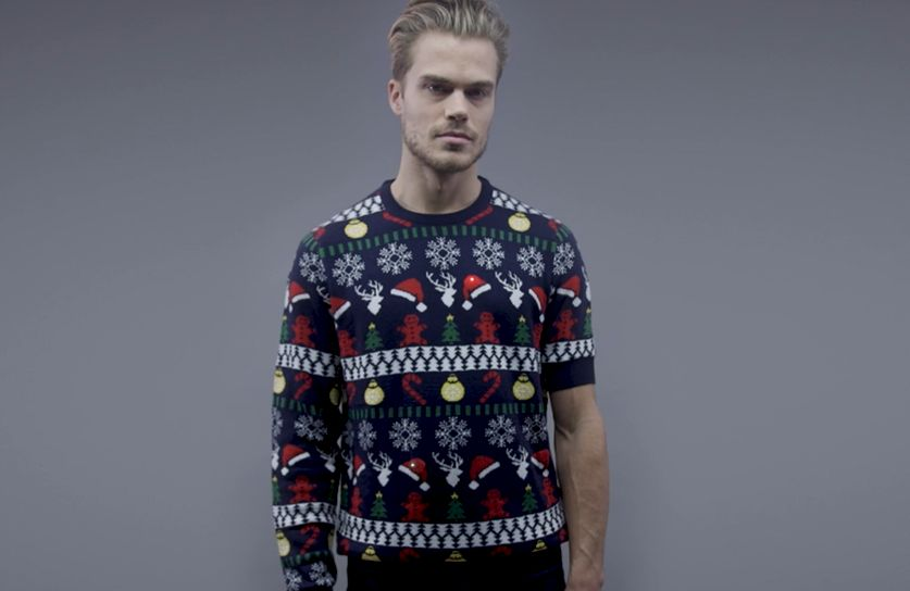 This Christmas Jumper Has One Short Sleeve for a Very Good Reason