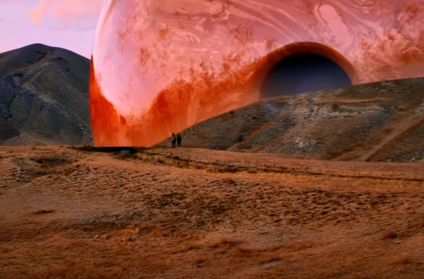 Planet Sized Bowling Balls in a Surreal Music Video for Milky Chance