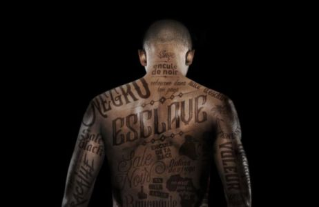'Human Billboard' Tattooed in Insults Protests Against Racism in France