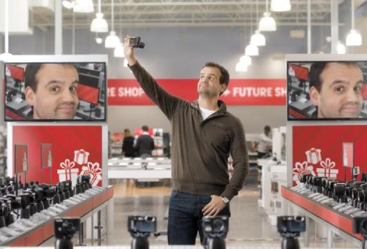 John St. Gleefully Shops for Tech in Christmas Future Shop Spot